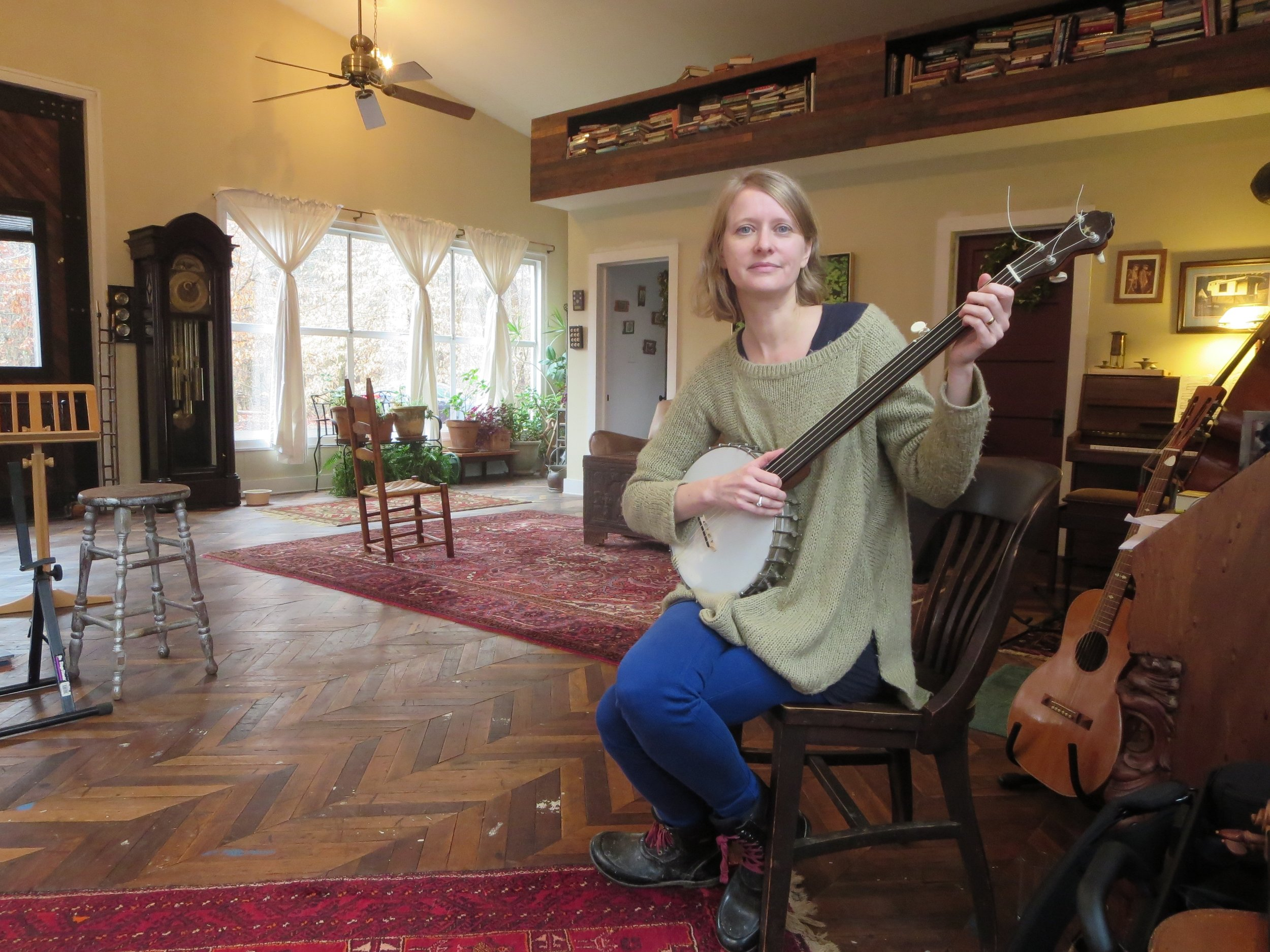 Alex Caton in her studio in Virginia. FIlled with light, instruments, and books.