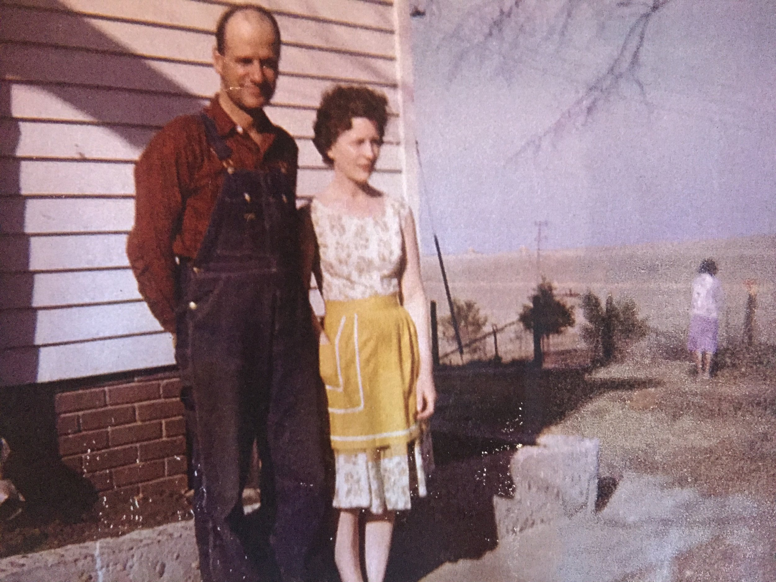 A young Marcella with her husband on the farm.
