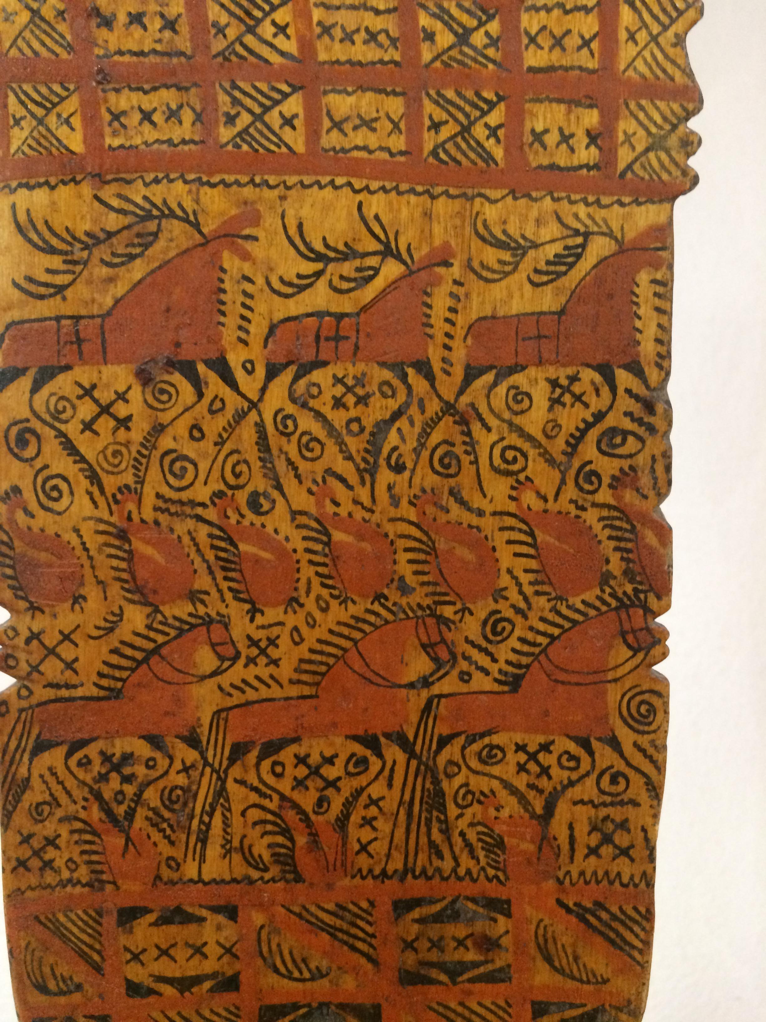 Detail of Mezen Carder, including images of caribou, horses, and symbology.
