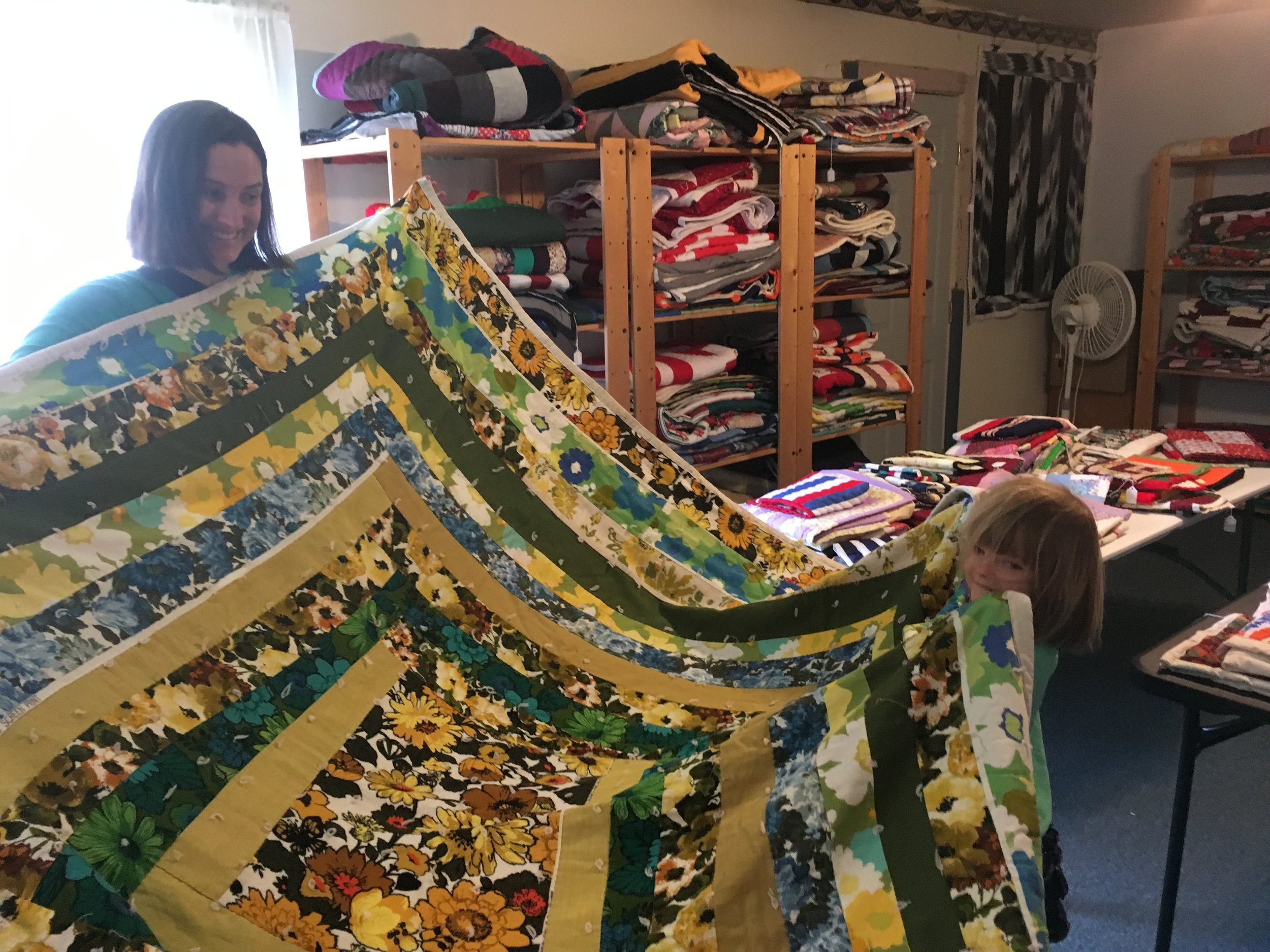 My niece wanted to be wrapped up in every quilt in the shop. Me too.