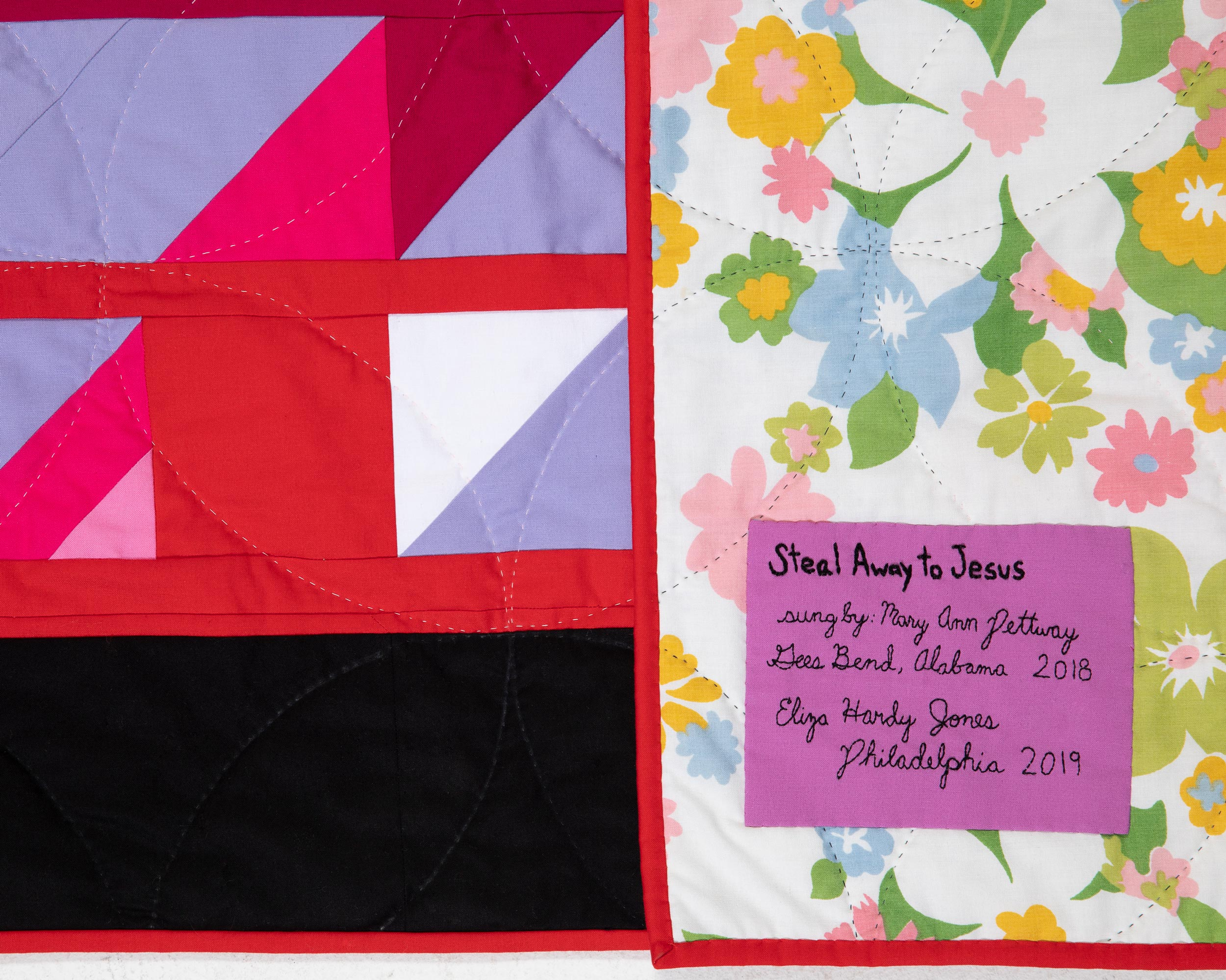 Scrap back with detail of hand quilting.