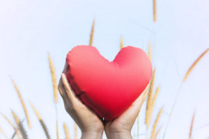 Hands-holding-a-heart-from-dreamstime-300x200.jpg