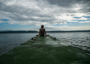 woman-sitting-at-the-end-of-a-dock-300x212.jpg