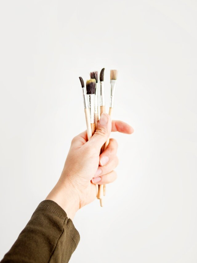 Person Holding Paint Brushes.jpg