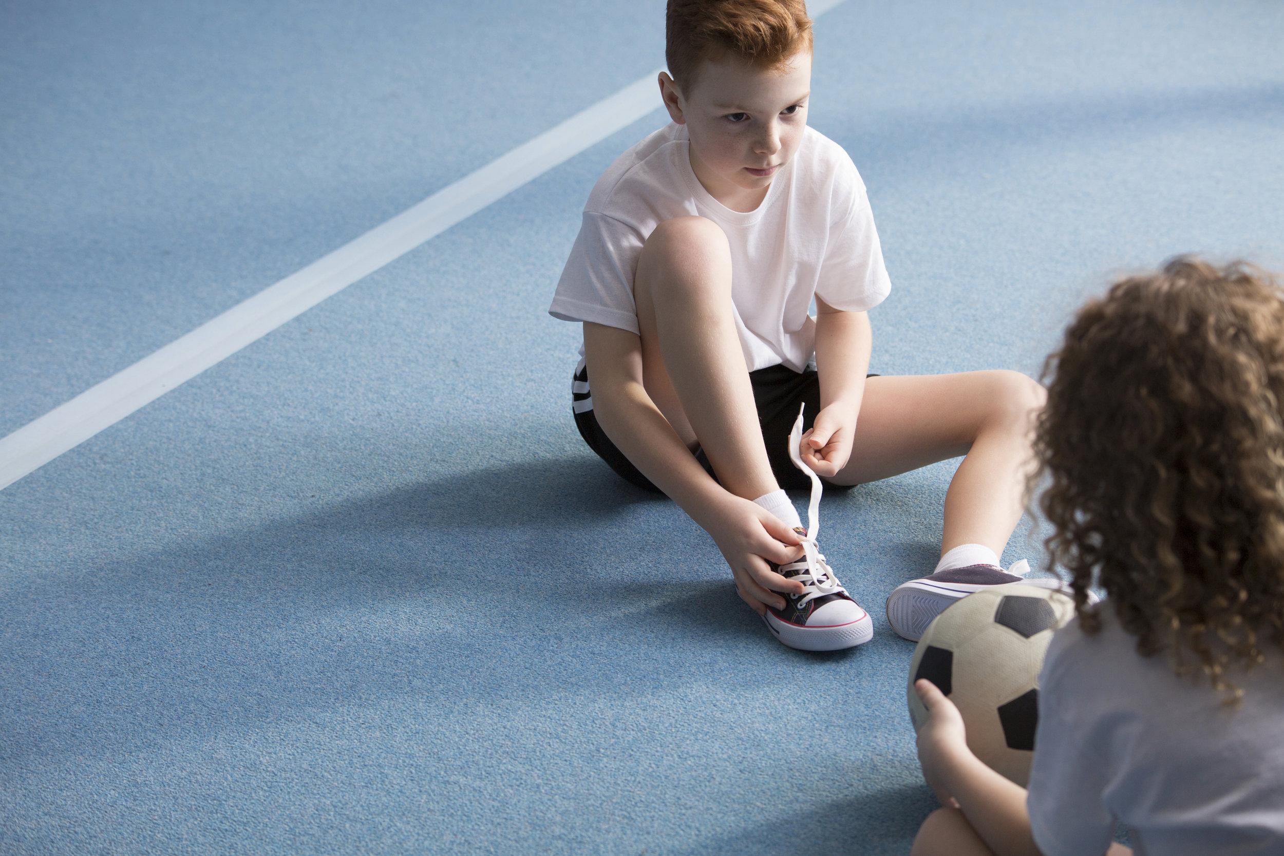 young-boy-tying-sport-shoes-F2L5H4C.jpg