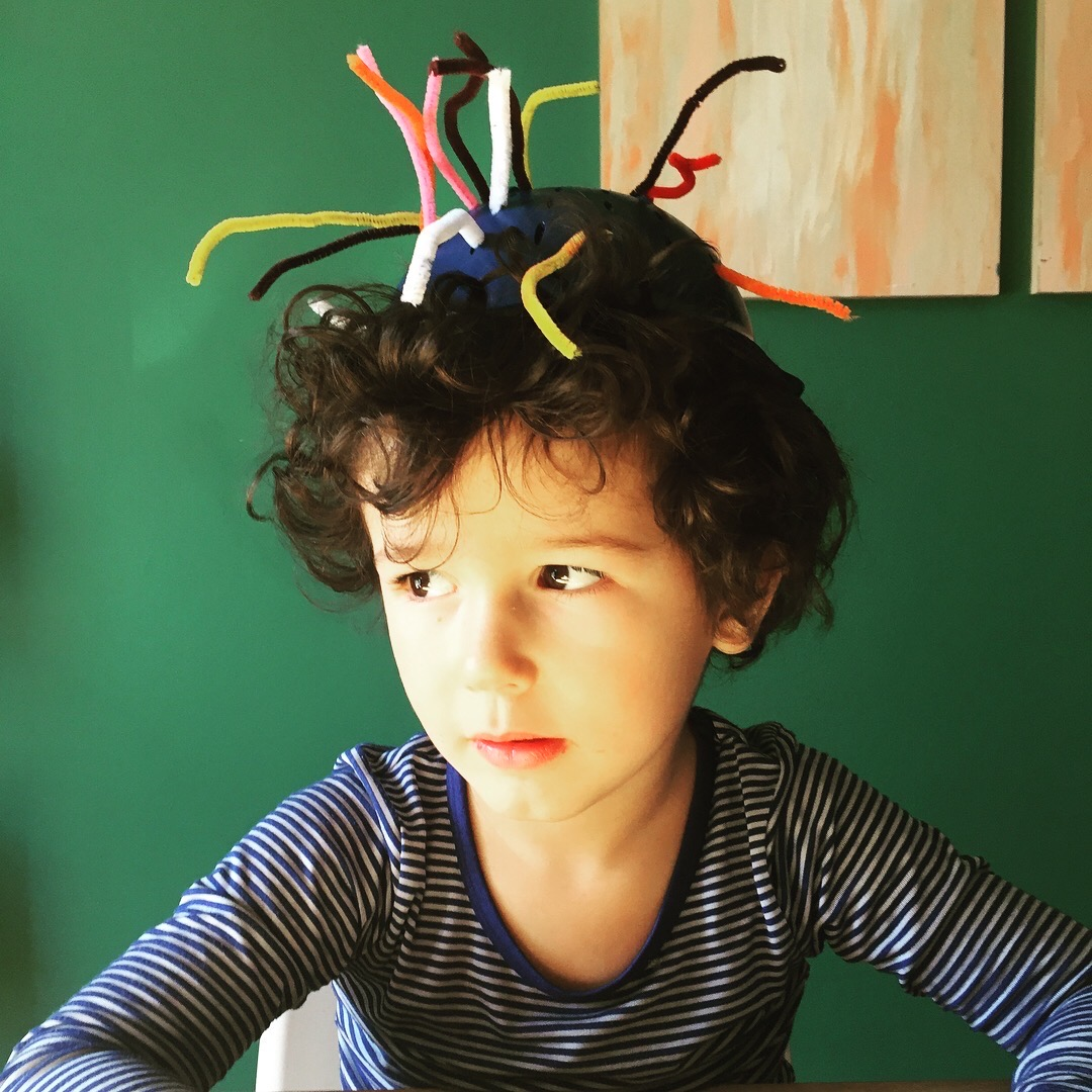 COLANDER SCULPTURE  Materials: colander, pipe cleaners  Process: Encourage your child to stick pipe cleaners through the small holes in the colander. This  Words: through, in, out, pull, push  Questions: What did you make? Tell me about…. I wonder if? What if we…