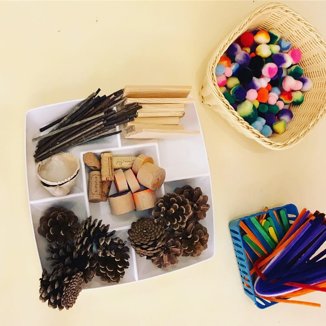 NATURE LOOSE PARTS PLAY  Materials: collected natural materials such as pinecones, shells, sticks, mixed with wood, cork, craft puffs, craft sticks (glue or play dough optional)  Process: Allow children to explore the materials. They may choose to combine or bind them, build with them, or just explore their properties.  Words: color words, descriptive words, texture, combine, build  Questions: What if we… What did you make? How does it feel?