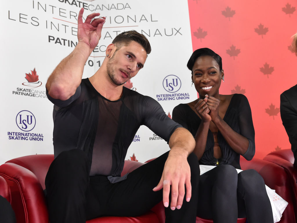 Vanessa James and Morgan Cipres celebrate in the Kiss & Cry after their record-breaking free program (   Photo credit: ISU   )