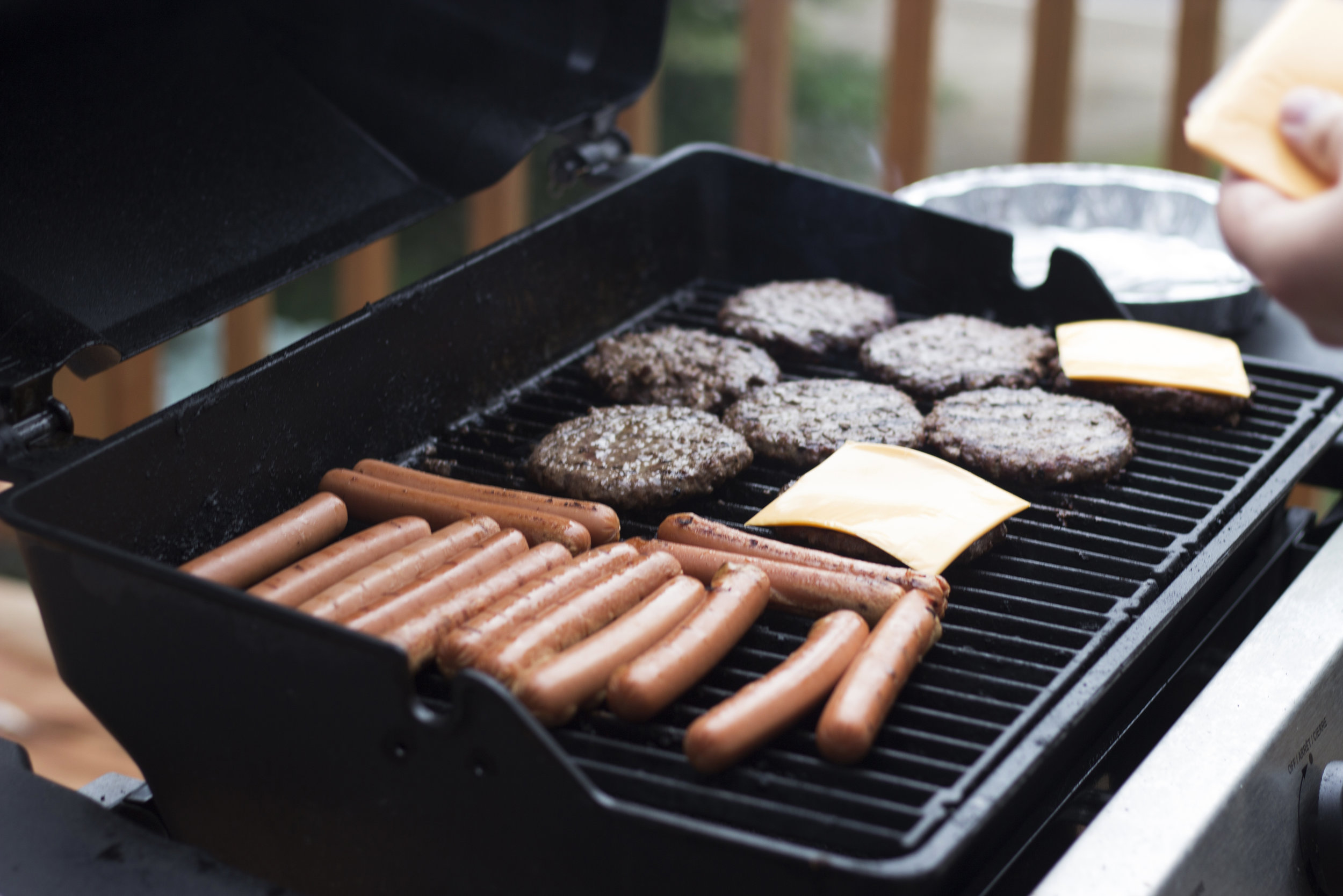 Burgers and dogs on the grill can be a great way to bring people together. Photo from Unsplash.