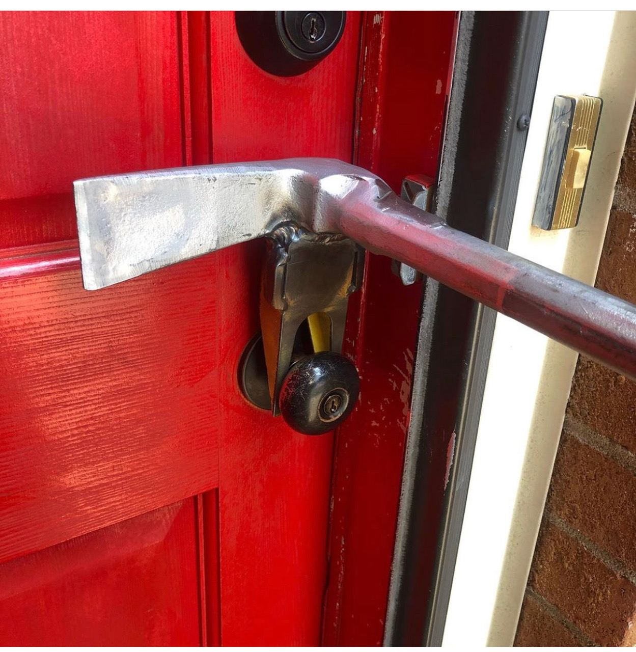 This modified halligan makes quick work of a locked door.