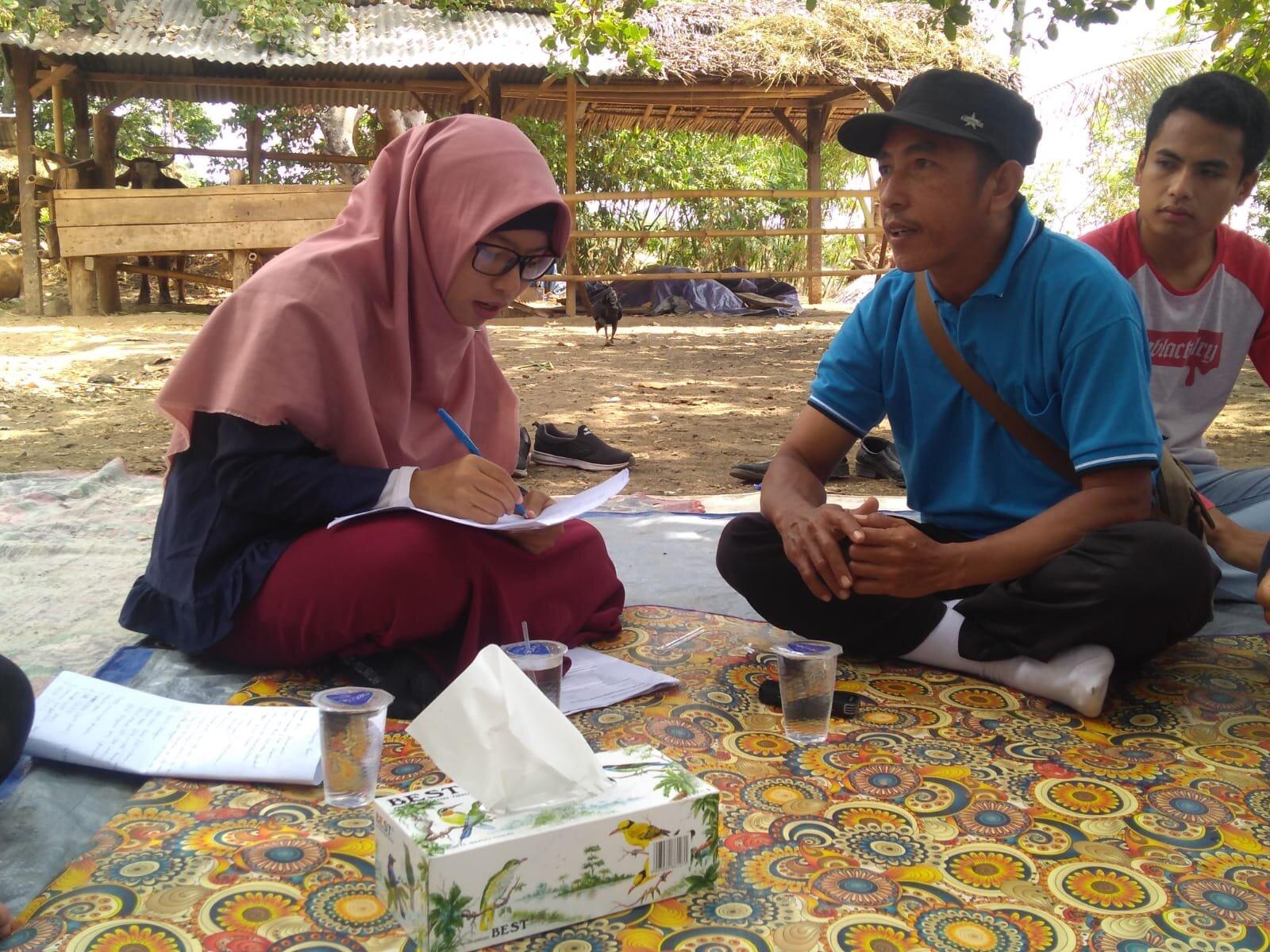 Field Officer Ms Baiq Ria Askina (L) interviewing a Dinas staff member, Pendua village, Lombok, September 2019.