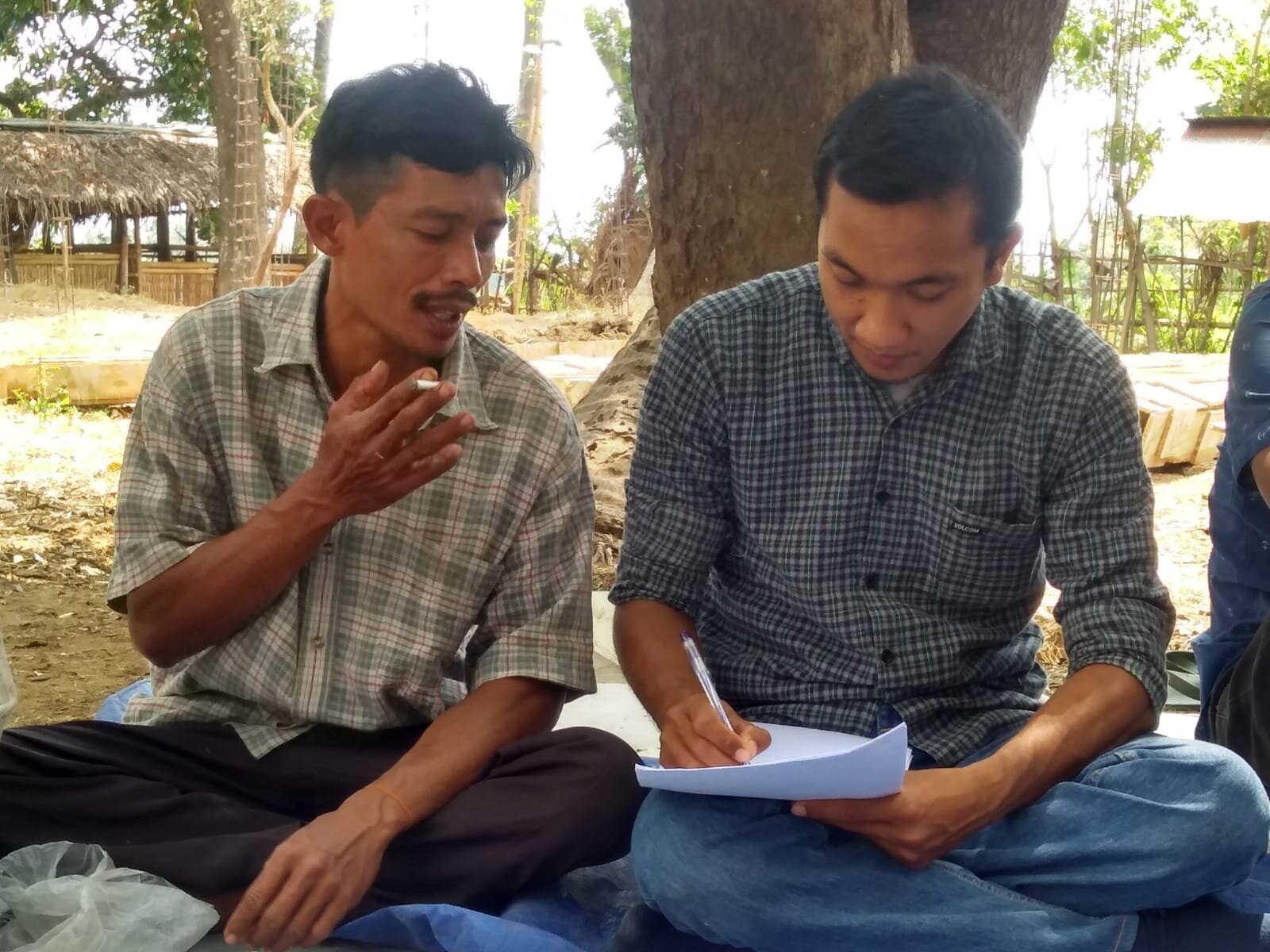 Field Officer Mr Muhamad Sukri (R) conducting an in-depth farmer interview during scaling research training, Pendua village, Lombok, September 2019.