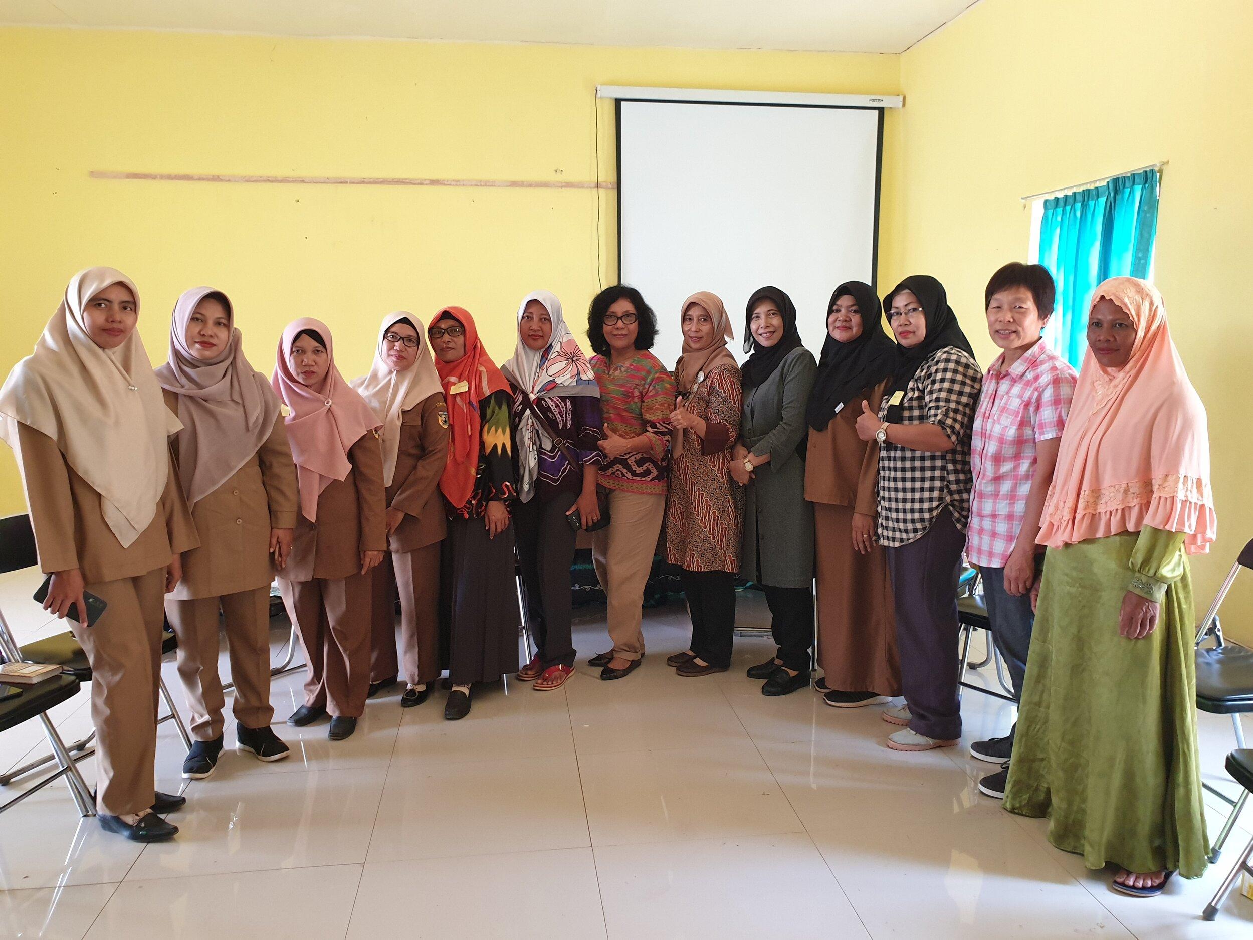 Women's gender Focus Group Discussion participants and researchers, Tanah Laut, KalSel, August 2019.  Photo: Rene Villano