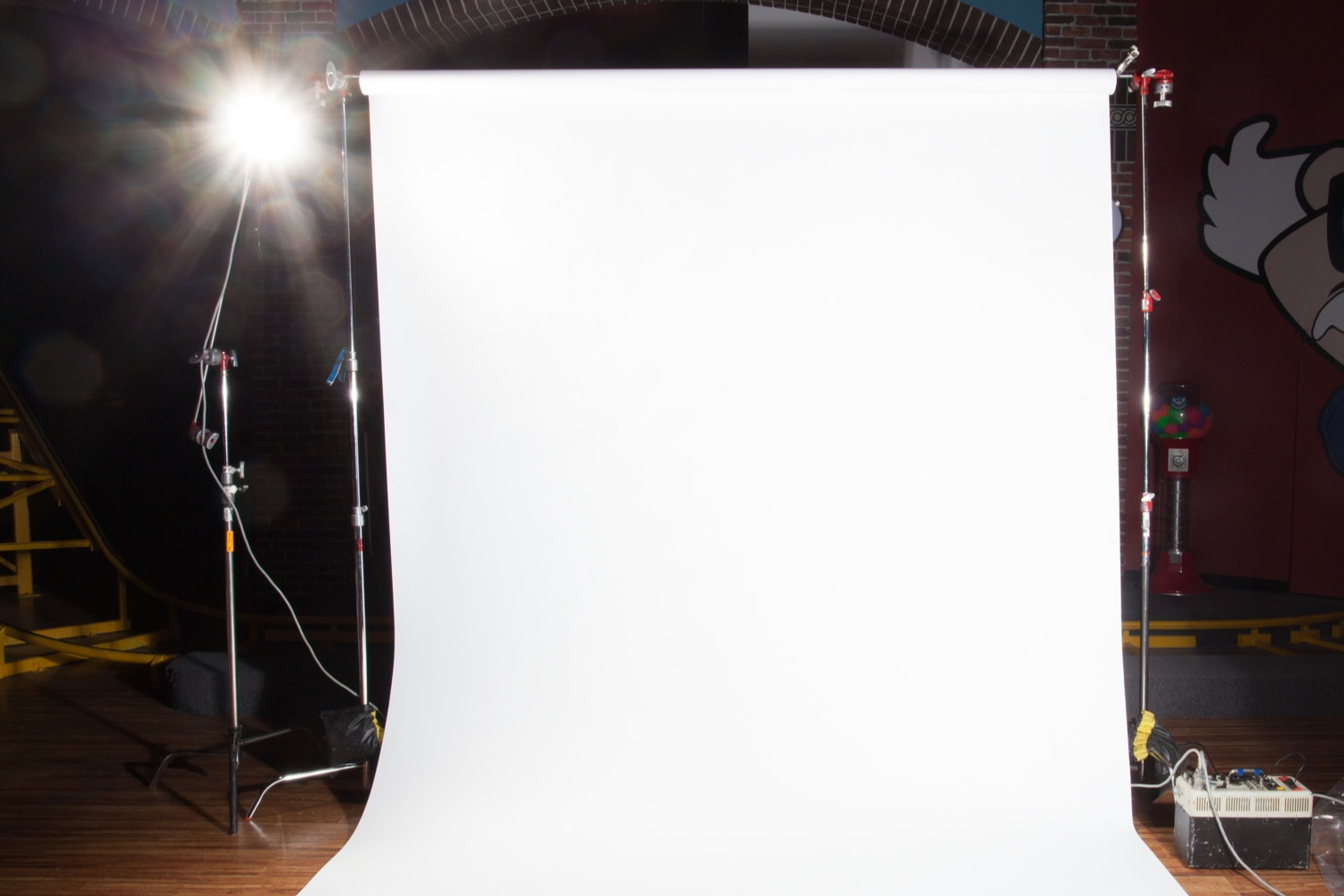 """9' Photo Backdrops - $80/day - With 2 C-stands and 2 bags, 2 pony clamps and 2'"""" paper tapeColours: Black, White, Cream, Grey, FlametoneAlso available: 4' GreyPaper waste is charged at $2 per foot"""