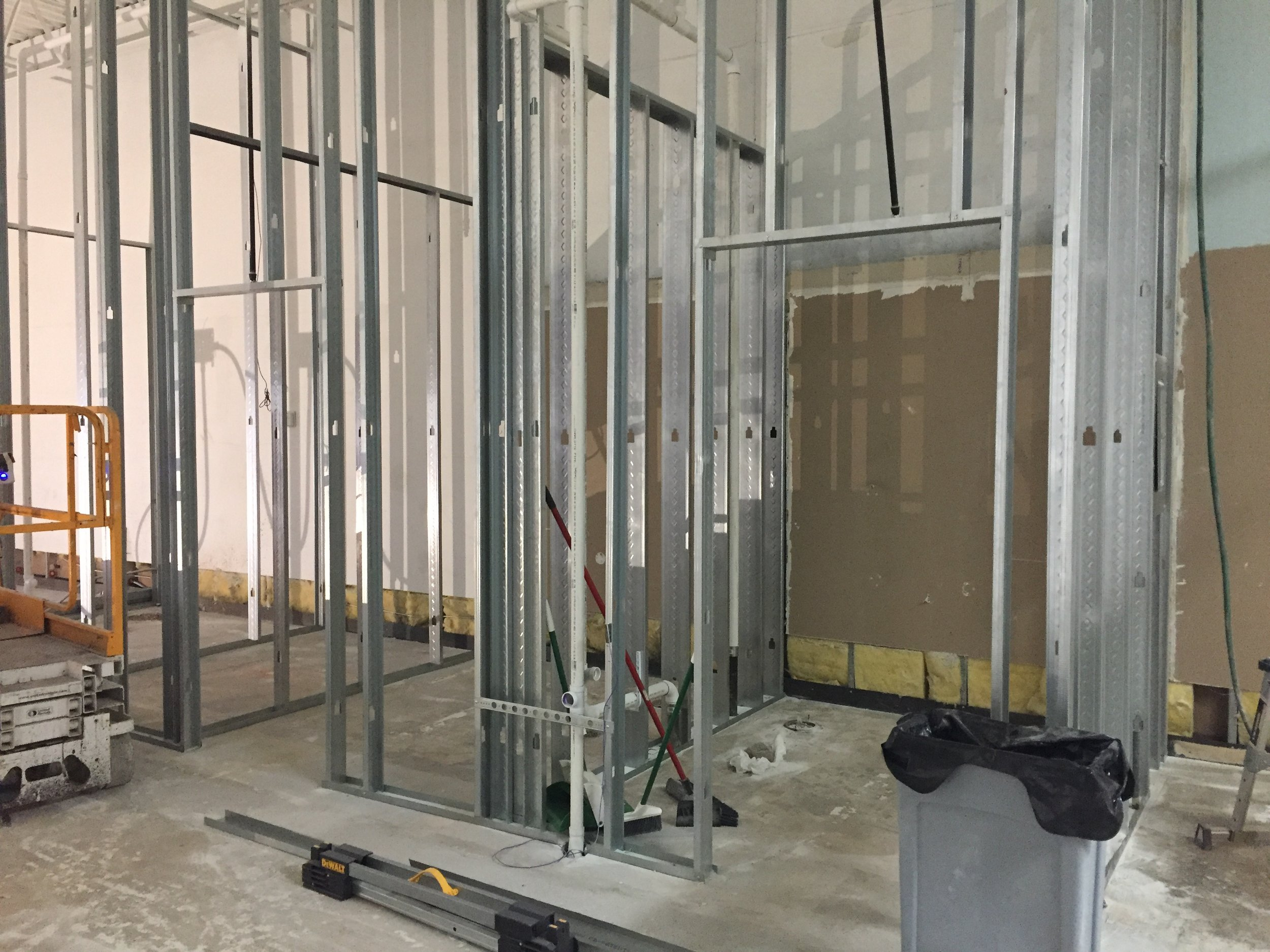 Restrooms with plumbing & framing complete!
