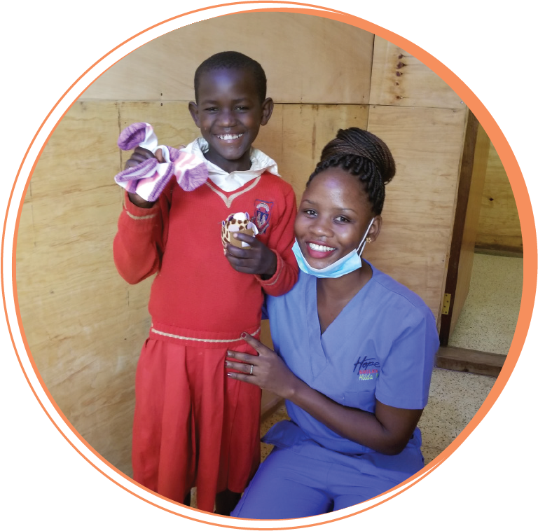 """Hilda Nanjobe  Dental Assistant  """"It feels good to wake up everyday knowing I am going to transform lives, most especially deep in the villages where people have no access to dental care. I feel happy because our team is an inspiration to many and I have learned leadership so we can transform lives as a team."""""""