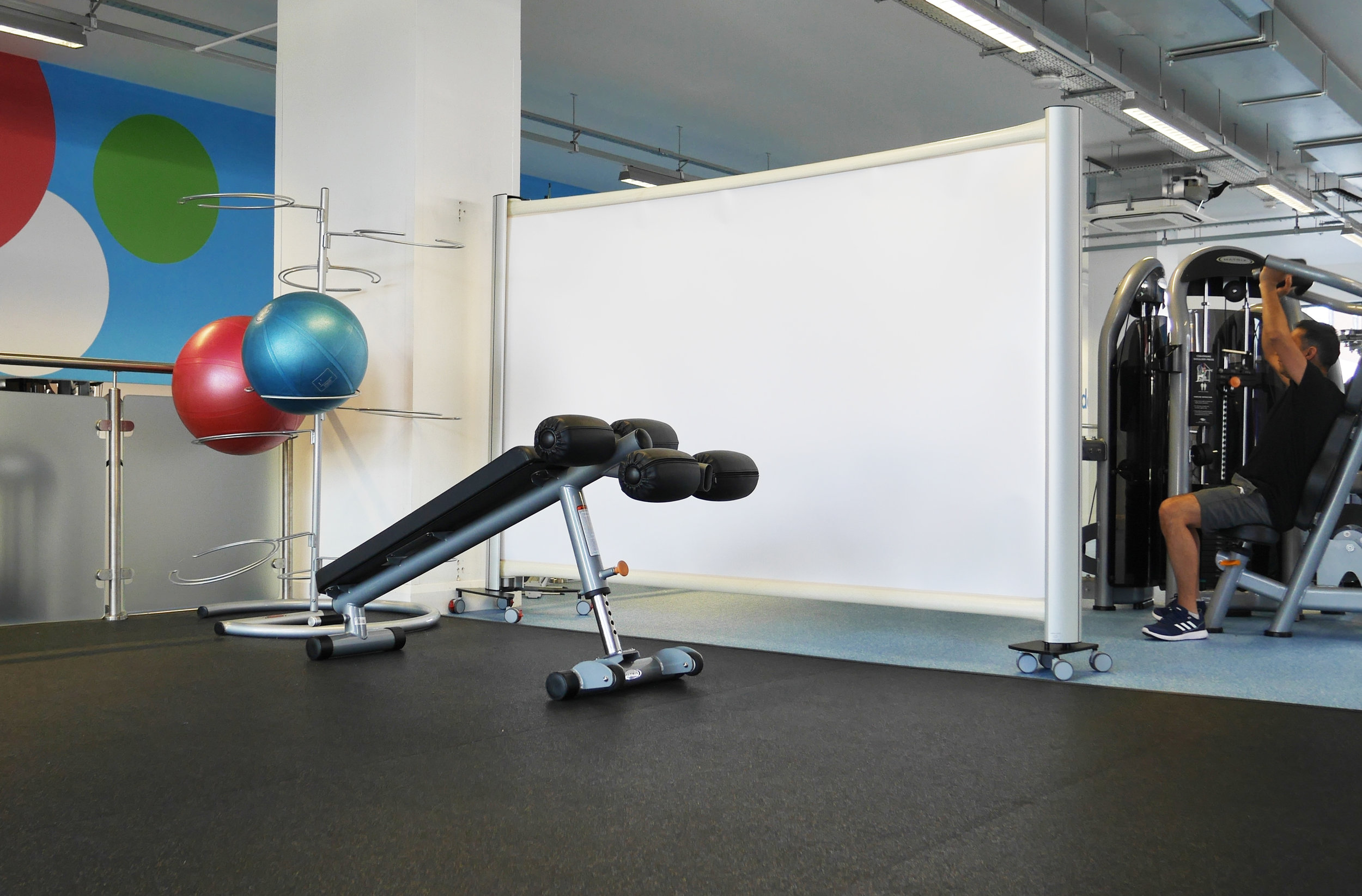 KwickScreen Pro at the Gym Group retractable privacy screen gym divider
