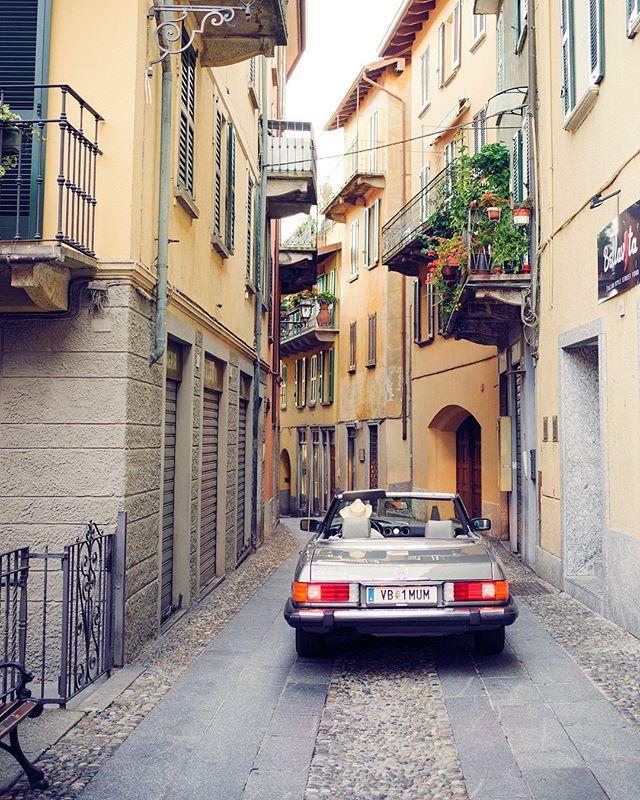 Through the streets of #belaggio . . . . #roadtrip #roadtripdiary #timetraveler #x1d #travelbloggeraustria #igersaustriaontour #roadtripping #mercedesclassic #mbfanphoto #mbclassic #oldbenz #drivetastefully #travelwithstyle #cartravel #carroadtrip #mbroadtrip #classiccartravel #r107 #mercedessl #takemethere #dametraveler #roadtripcouple #travelgirl #timetravelgirl #mercedesgirl #shesmercedes #lakecomo #ig_italia #lakecomo