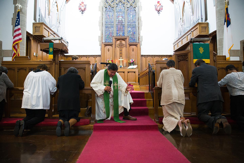 Pastor David Hall prays at the alter