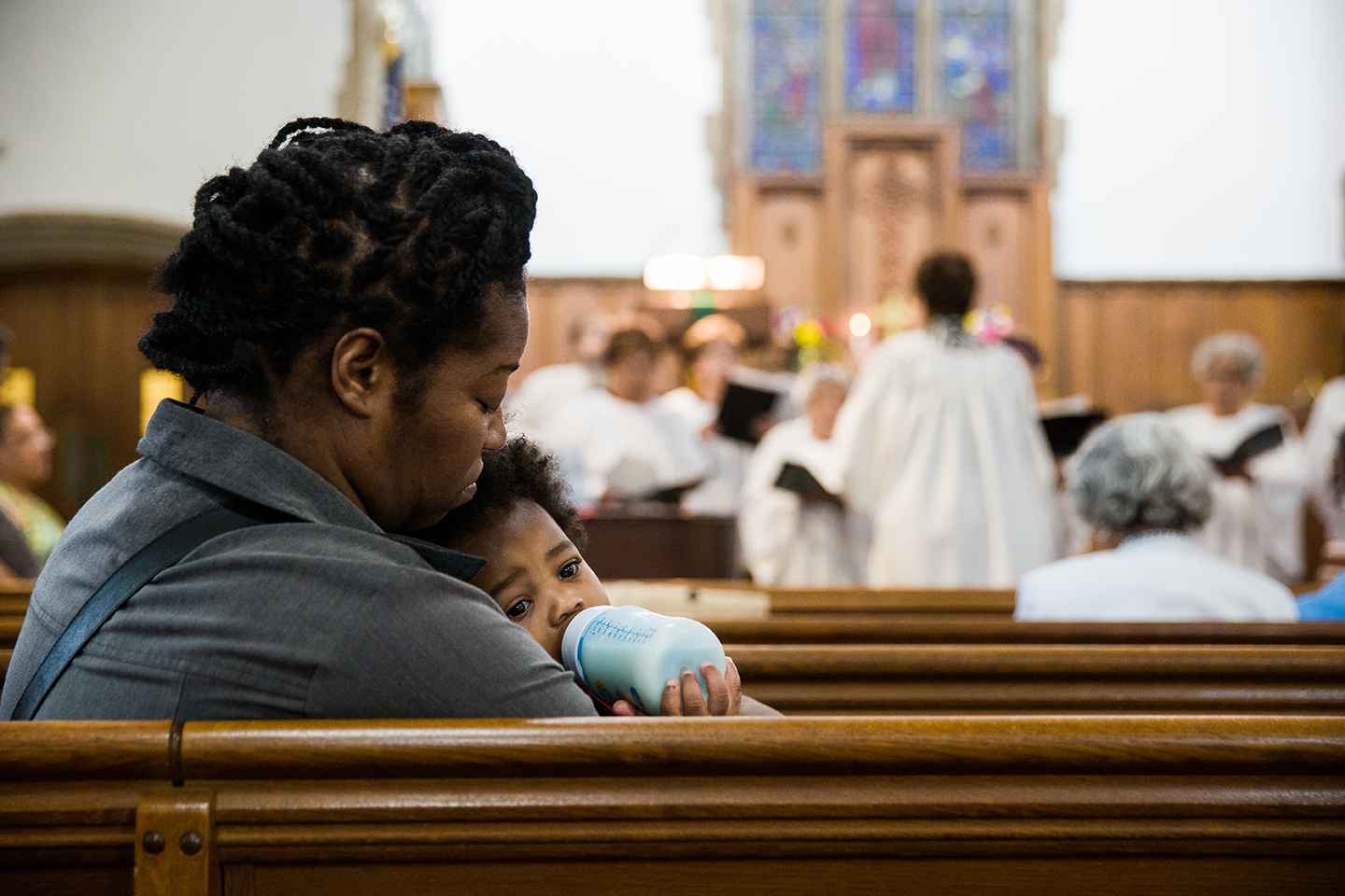 A mother holds her child during a worship service at McKendree UMC in Washington D.C.