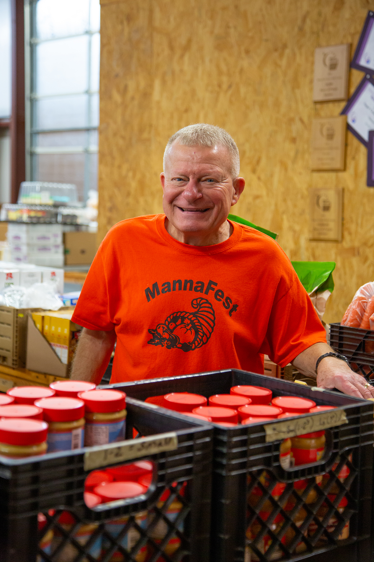 john muzny stocks manna fest shelves in livingston, TX