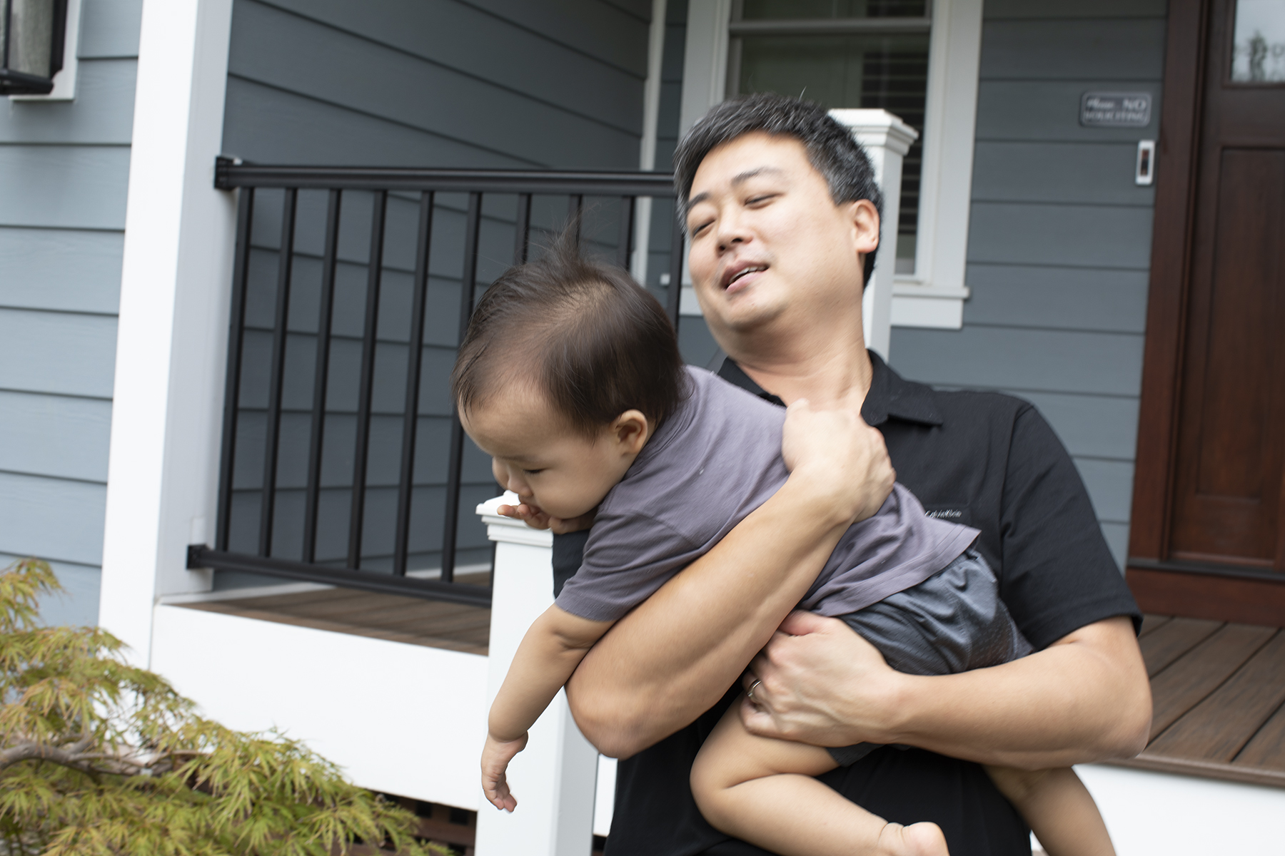 Pastor Daniel Park and son in front of their new parsonage in McLean, VA.