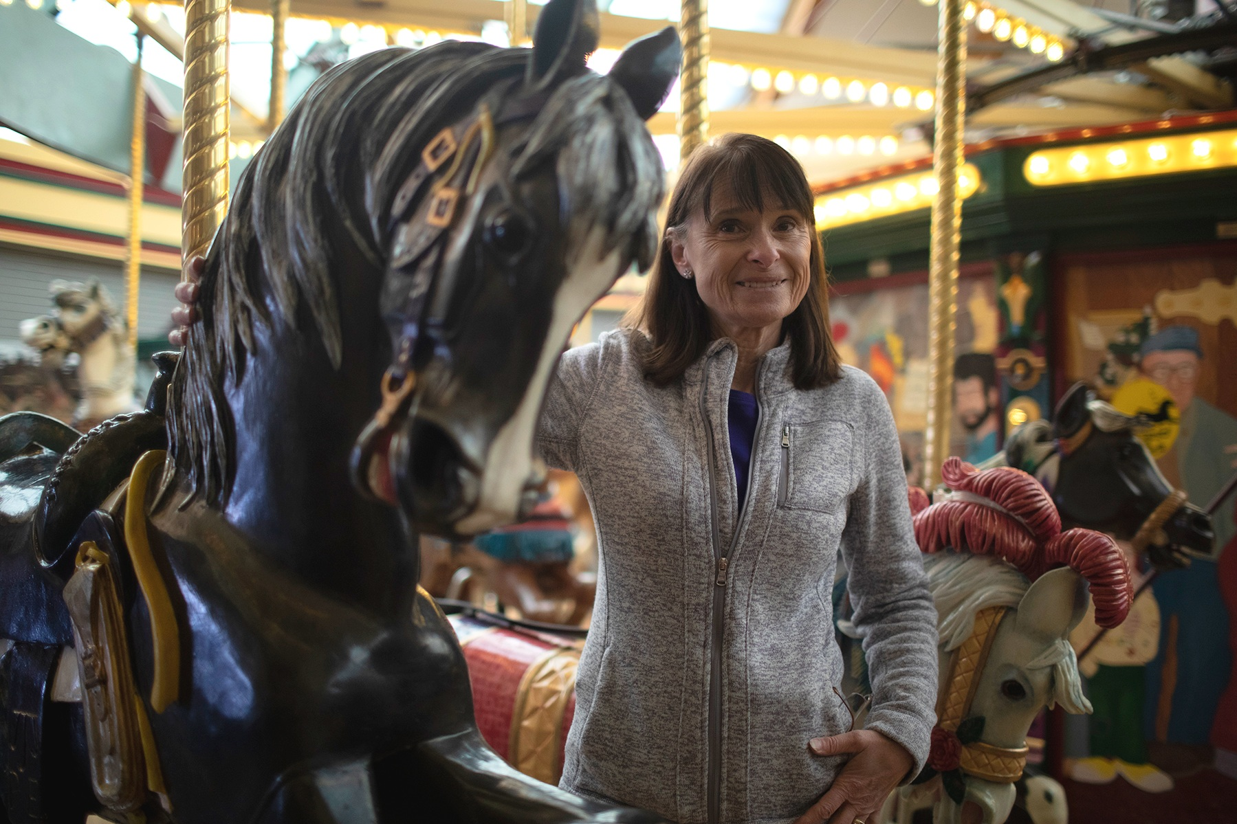 Theresa Cox, FUMC Missoula Building Finance Team Chair, leading a mini tour of Missoula's carousel.