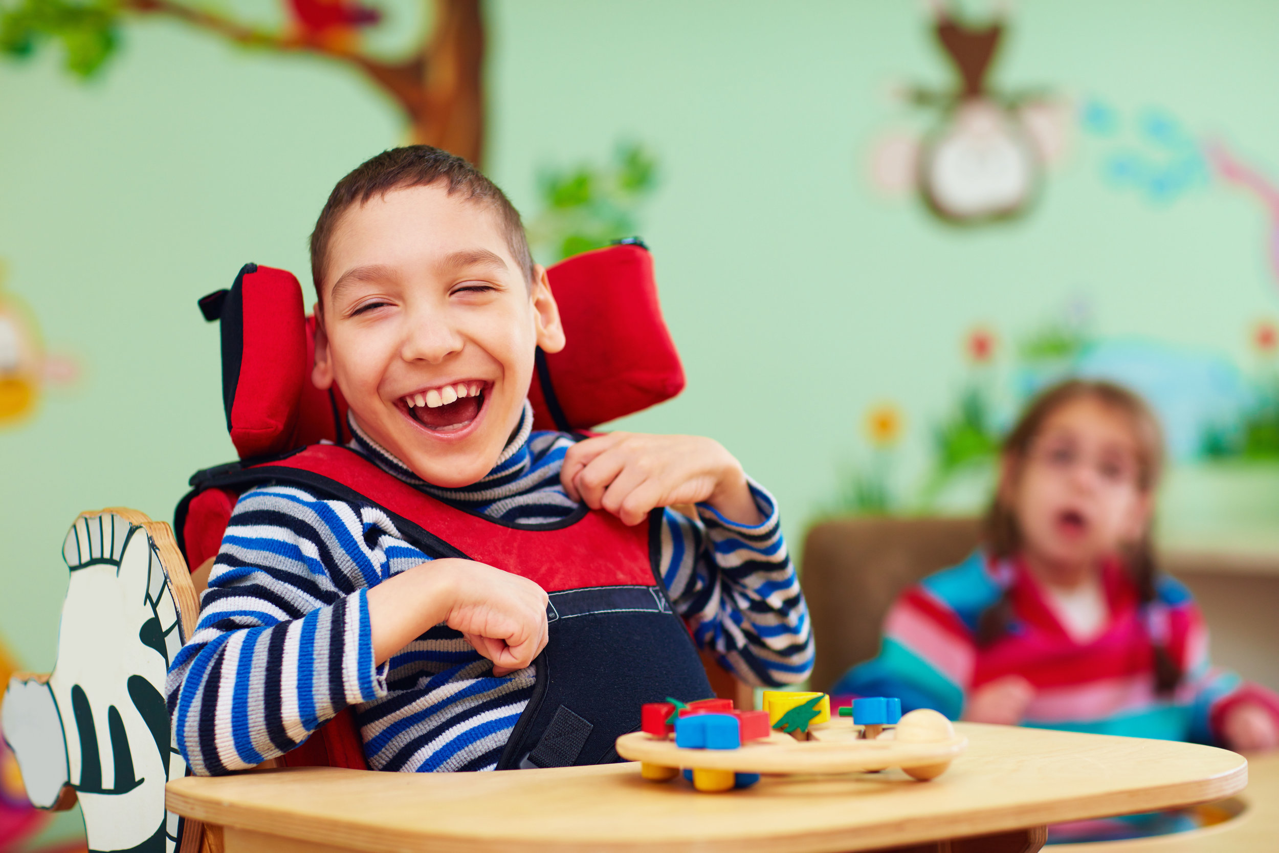 Young man with cognitive disabilities smiling.