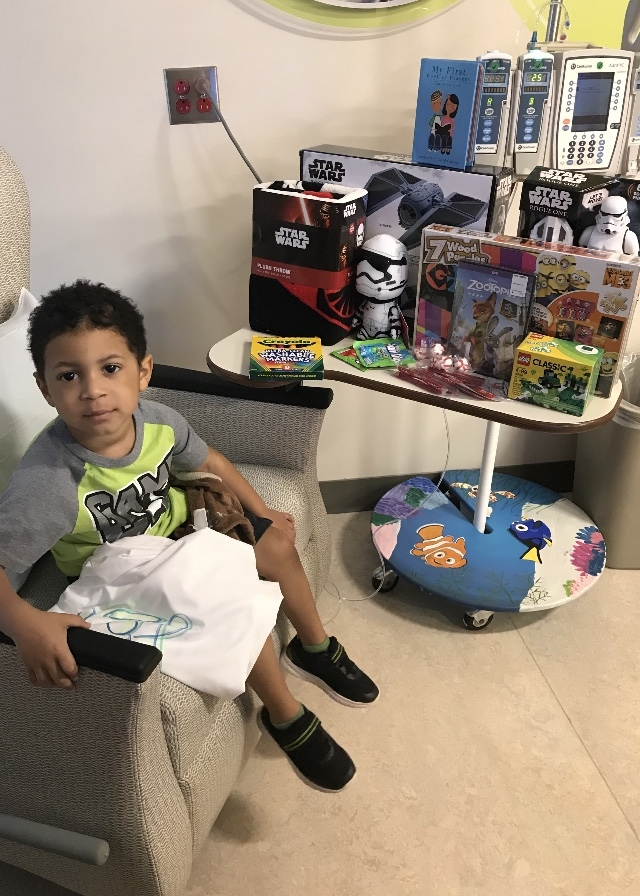 Amari Kalu, who has cancer, B-cell Acute Lymphoblastic Leukemia, and is in active treatment. The photo shows the gifts he received from our pillowcase donations.