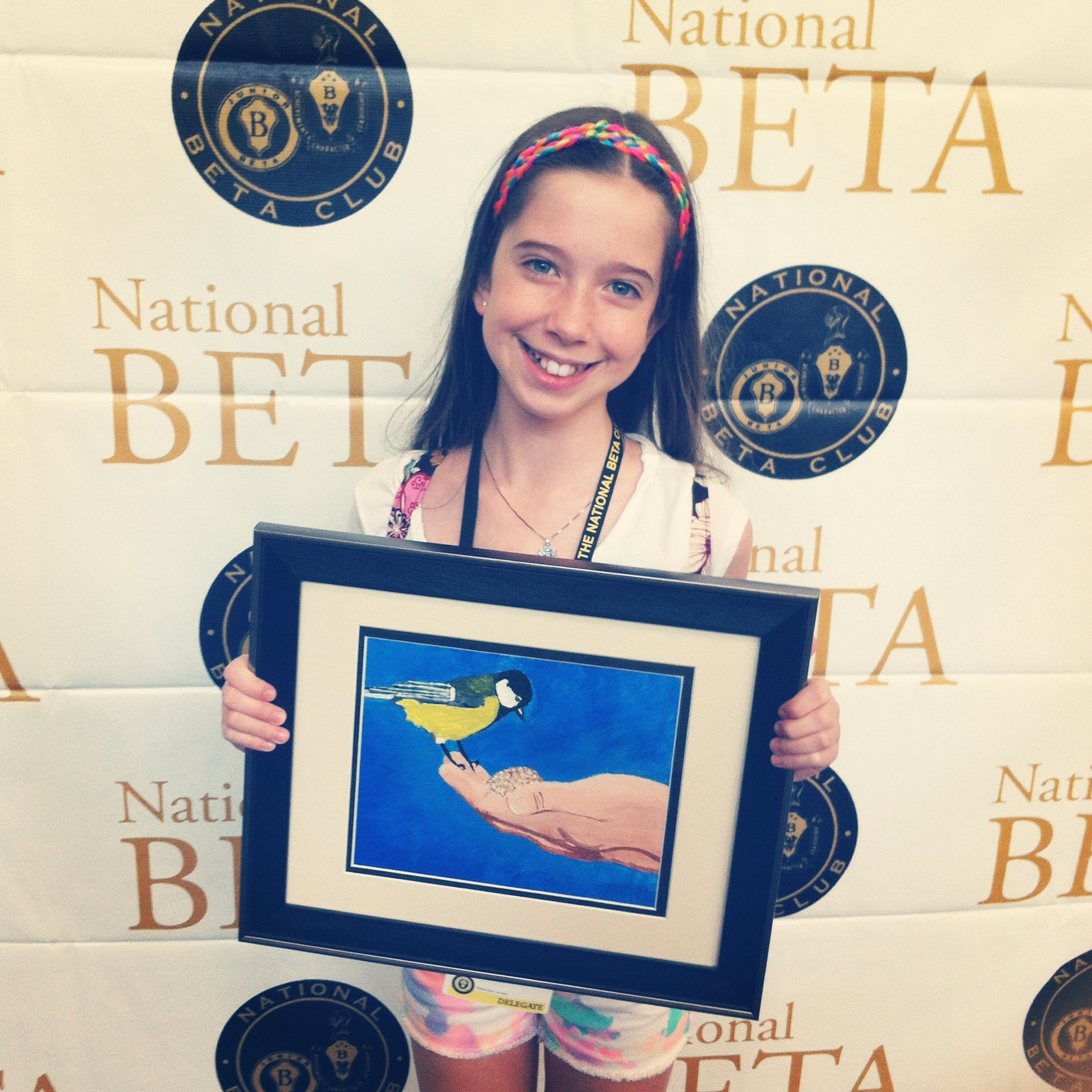 """Bella with her yellow bird painting, she titled """"Random Acts of Kindness"""" - June 2014"""