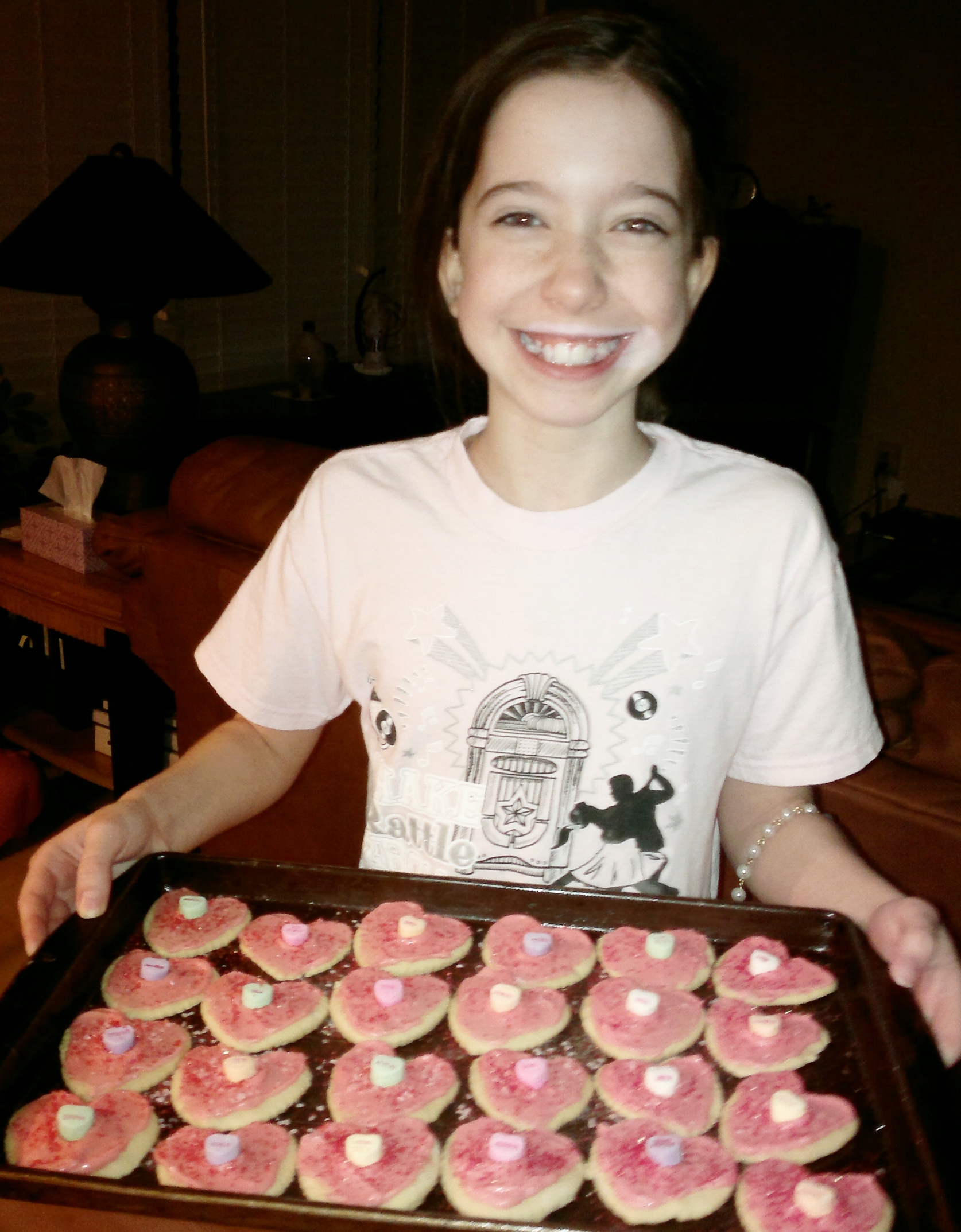 Bella with cookies she helped make for the staff at the nursing home - Feb 2014