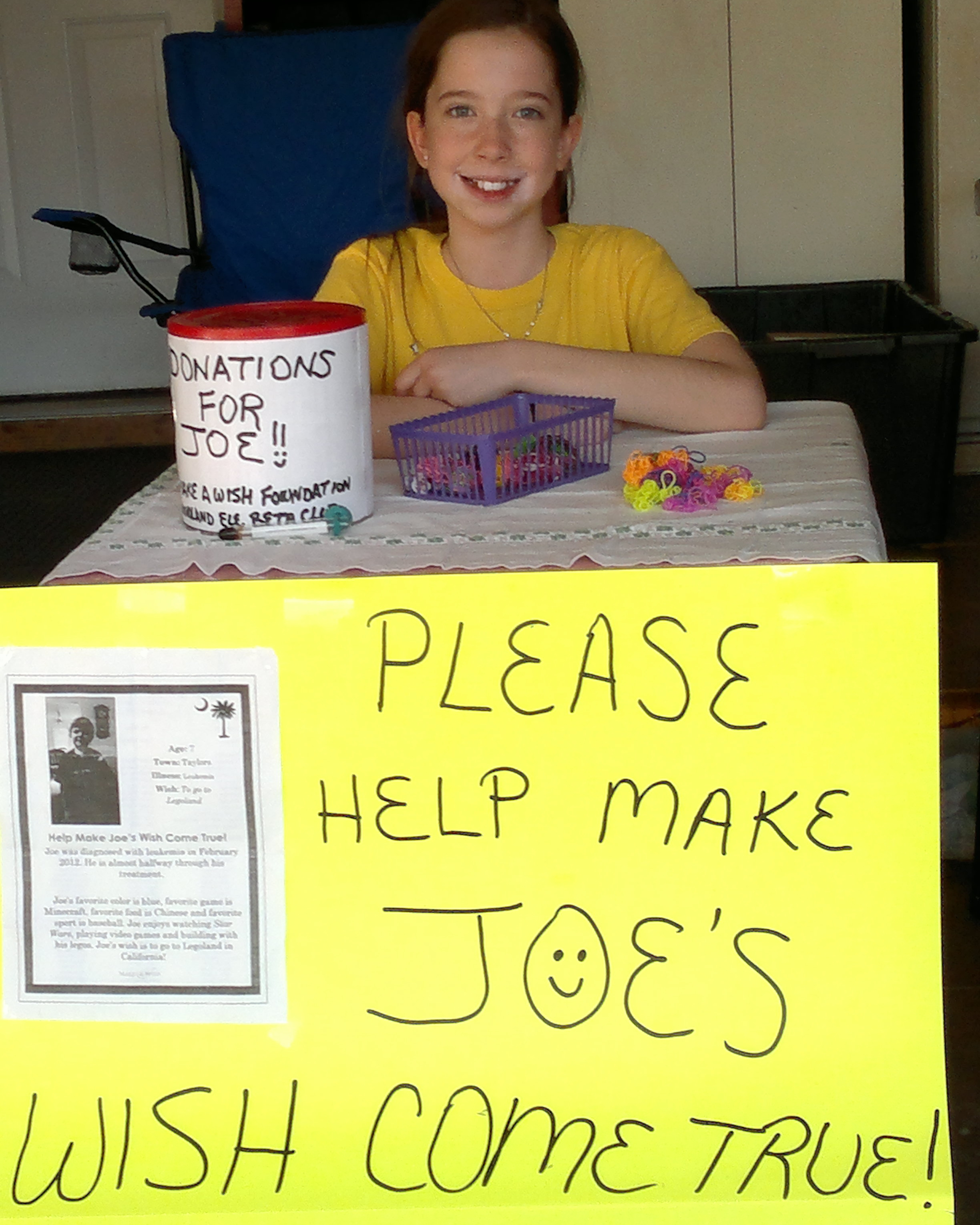 """Bella with table she set up to raise money for """"Joe""""- April 2014"""