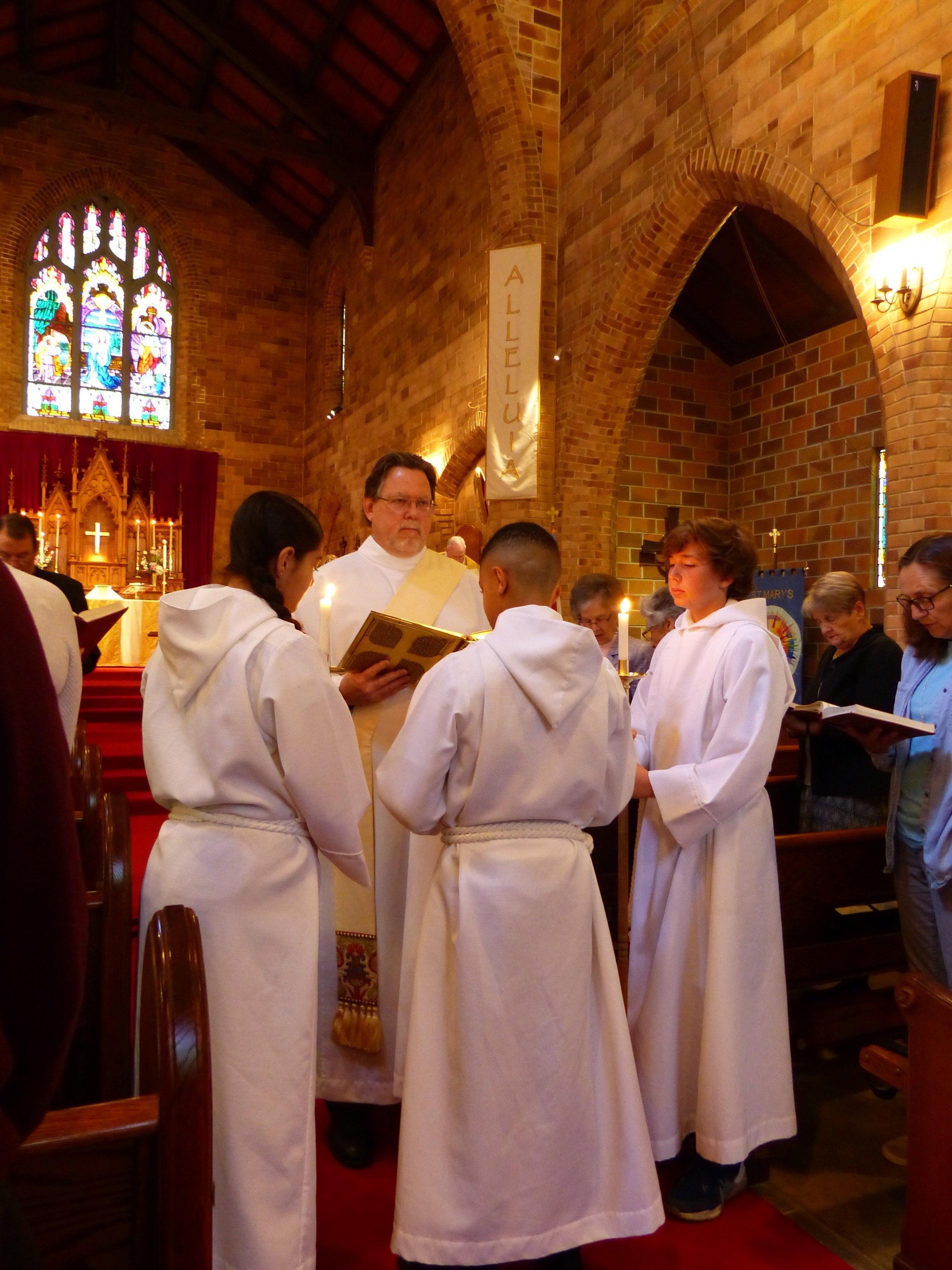 Deacon Don proclaiming Gospel.jpg