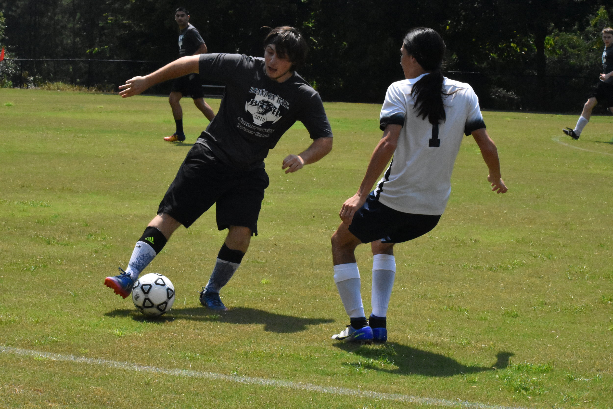 Alumni Soccer Game - On Orientation Weekend, a battles for the ages is held - the Varsity Soccer team puts their training to the test in a scrimmage game against a team of alumni and faculty.