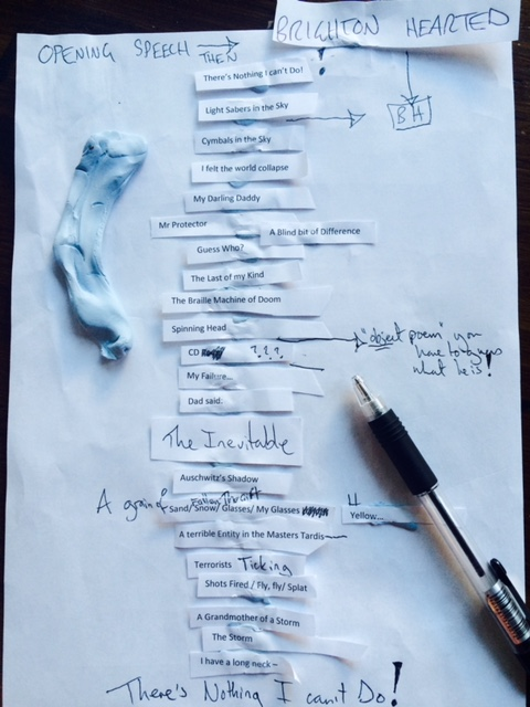 Image Description: Photograph of bits of white paper with handwritten notes stuck in order of the layout of the A Blind Bit of Difference poetry book. Also pictured: A black pen and a blob of Blue Tack