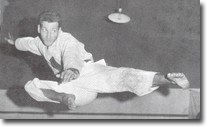 Sensei Ninios, perhaps the most famous picture of him, mid flight in a flying side kick.