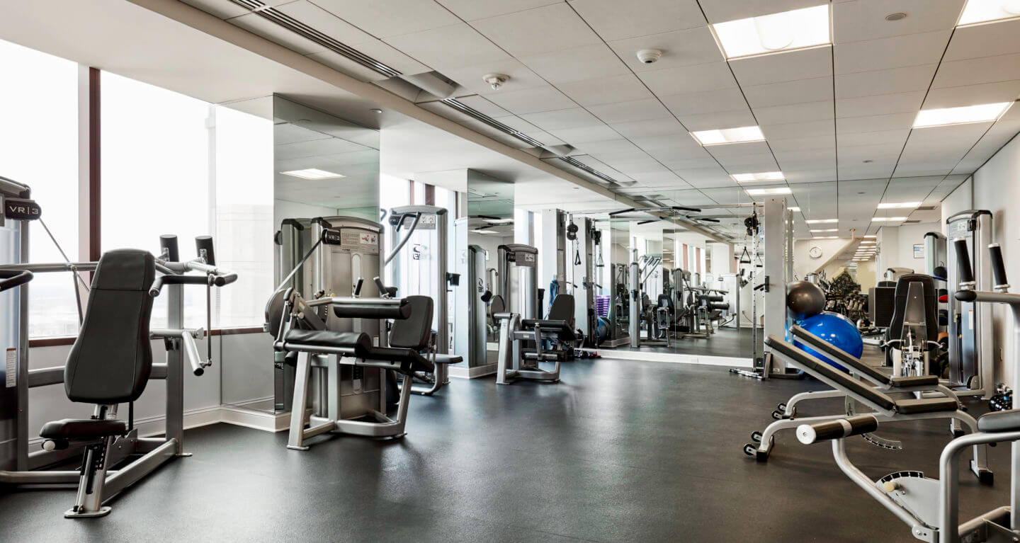 Full gym open 24/7 with yoga room and personal training area.