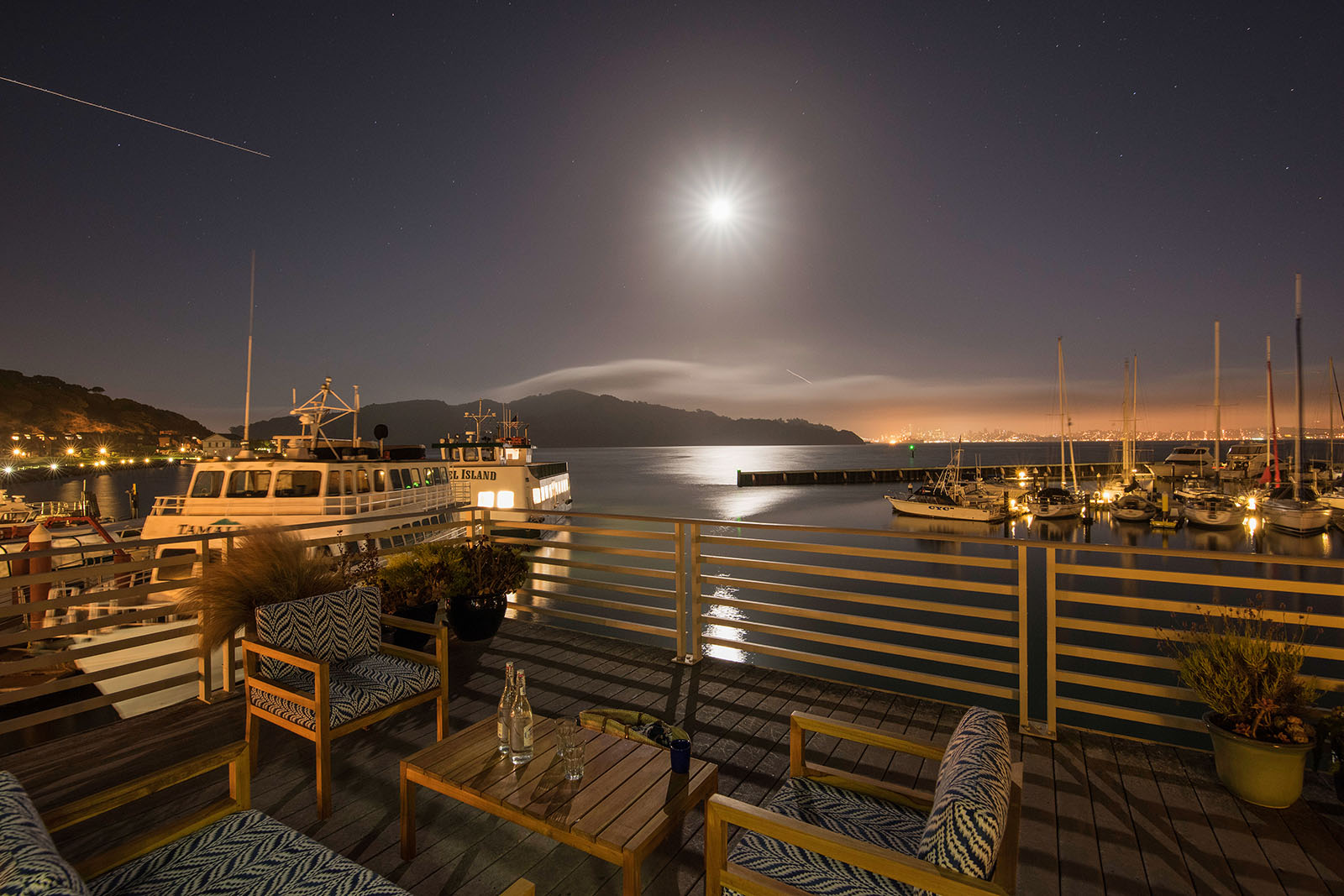 Settle in and enjoy the full moon from the deck at Waters Edge Hotel