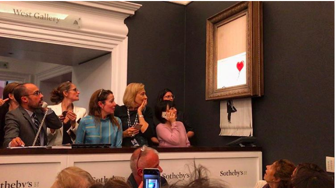 Surprised onlookers react as Banksy's  Girl With a Balloon  self-destructs at Sotheby's.