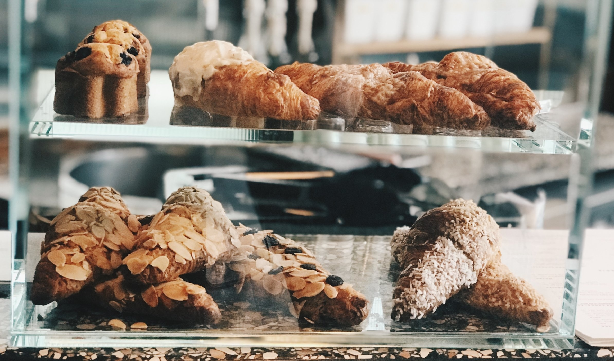 Muffins, scones + croissants are all great options. Plus, chances are that they're fresher, easier to chew (higher moisture content) and have better ingredients than any energy bar that has been sitting on a shelf for weeks.