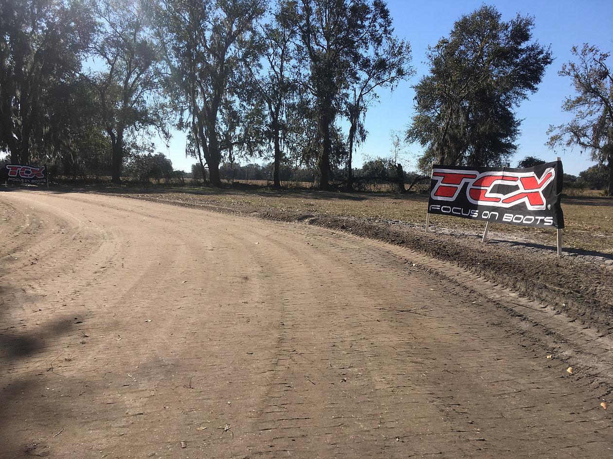 (Exit of turn 2 on the mini short track at 10 Training after preparing again after the rain storm the night before)