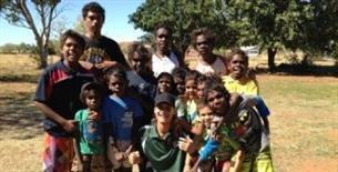 Fitzroy Valley Remote Communities Athletics Workshops. Western Australian junior sprint champion, Asad Hosseini, with aspiring Yakanarra sprinters