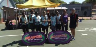 Winning team, Warmun, pictured with their coach Shonece Purdie and umpire Leah Allen