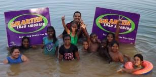 Yurmulun Kids enjoying a cool off during a water safety session. Left: D'Anjua Callaghan,Tia-Rae Charles, Chantelle Shovellor, Brandy Charles, Aleerah Ozies, Jack Macale, Brendan Charles, Kamahl Maru, Shai-ann Ozies, Shi-ahn Dwyer. Back: Smarter than Smok