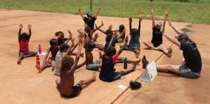 Fairgame volunteers teach Yurmulun kids how to play Wedged Tailed Eagles.