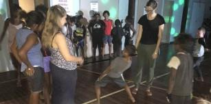 Young people enjoying limbo at Disco Night in Fitzroy Crossing