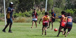 Garnduwa trainee Andrew James umpiring the game