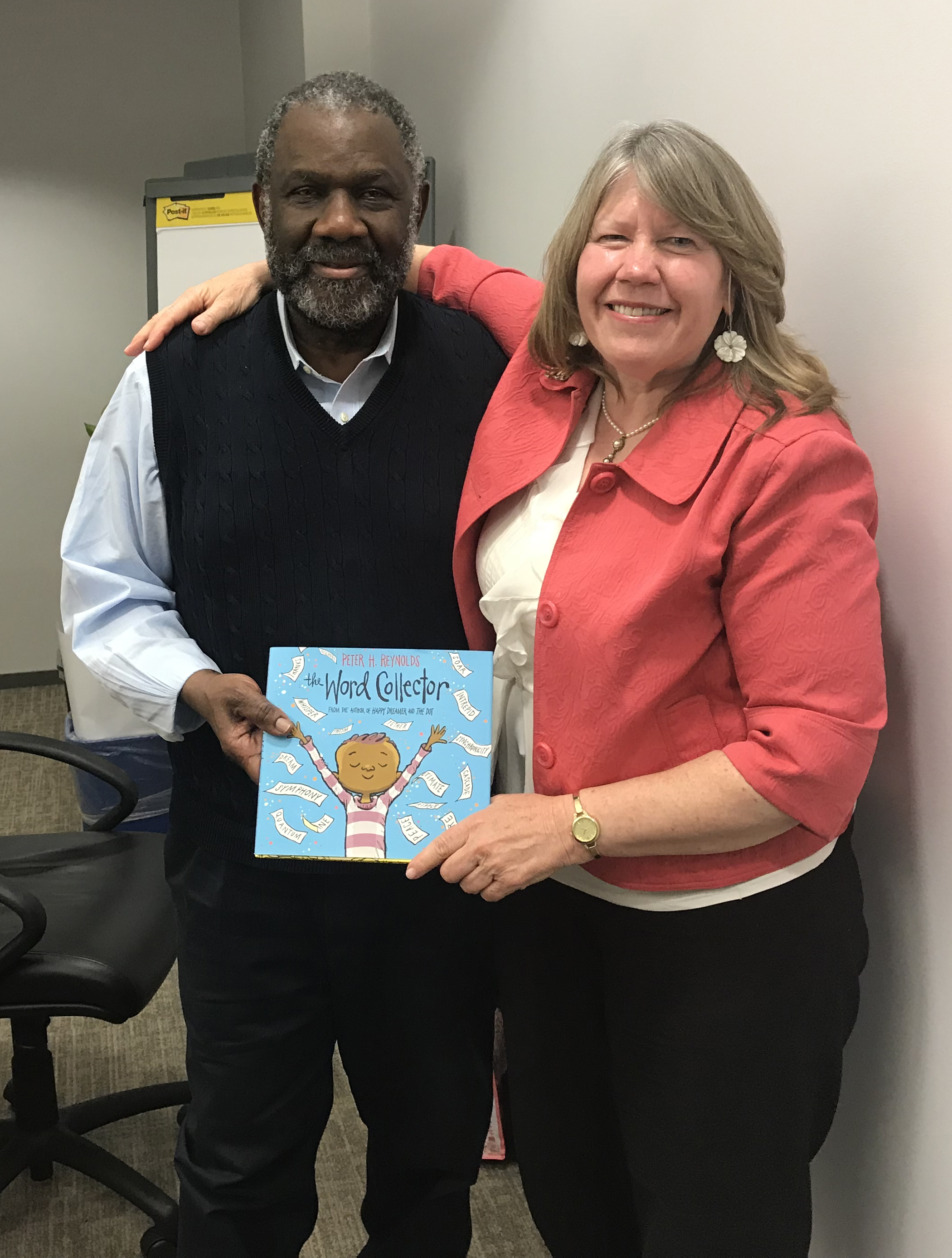 Brigid Hubberman presents Ralph Smith, VP of the Annie E. Casey Foundation, his own copy of the Word Collector.