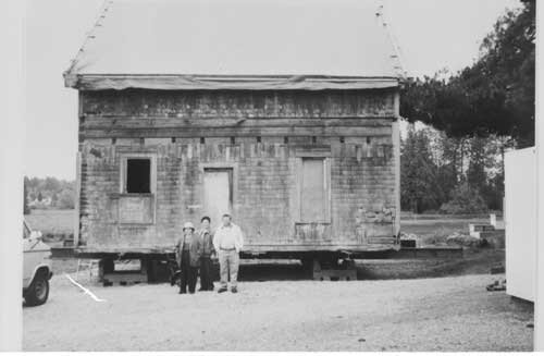 The Matsuoka Cabin was moved to Larsen Lake in 1989. At the time it belonged to the Masunage Family. This photo shows the Masunaga Family along with this historical cabin.  From left to right:  Yeizo Masunaga, Yeizo's wife, and Mrs. Taki Masunaga.