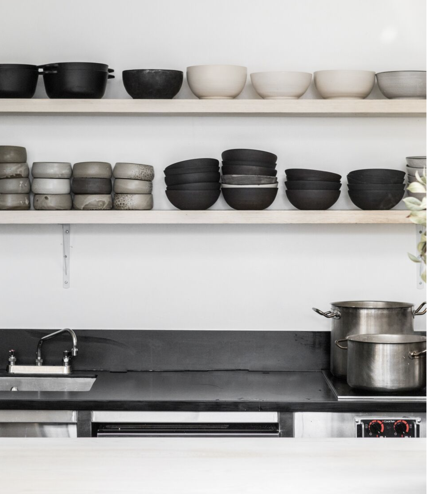 In the food prep areas, Kahn used composite quartz in the food-prep areas. For more on the subject, see  Remodeling 101: Engineered Quartz Countertops .